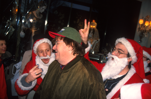 Santas in NYC -Michael Moore with Santas in NYC - photo Harrod Blank
